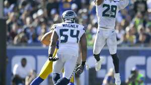 Seattle Seahawks free safety Earl Thomas, right, intercepts a pass intended for the Los Angeles Rams during the second half of an NFL football game Sunday, Oct. 8, 2017, in Los Angeles. (AP Photo/Mark J. Terrill)