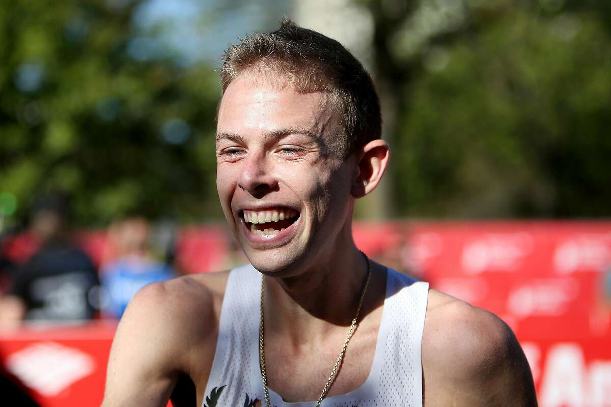 CHICAGO, IL - OCTOBER 08: Galen Rupp of the United States celebrates after winning the men's race with a time of 2:09:20 during the Bank of America Chicago Marathon on October 8, 2017 in Chicago, Illinois. (Photo by Dylan Buell/Getty Images)