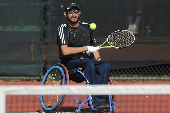 Joey Sanchez competes the consolation match of the Quad A singles during the second annual Cougar Open Wheelchair Tennis Tournament at Memorial Park Sunday Oct. 08, 2017.(Dave Rossman Photo)