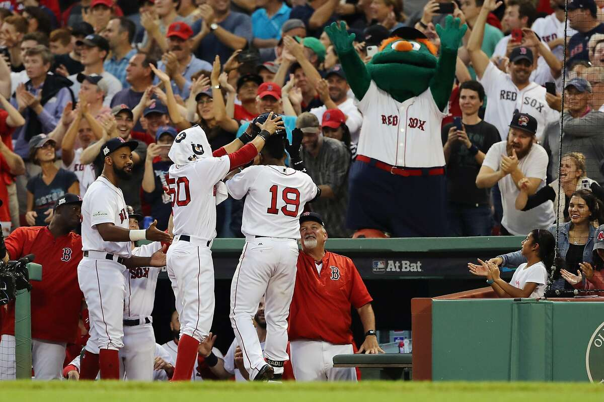 BOSTON, MA - OCTOBER 08: Jackie Bradley Jr. #19 of the Boston Red Sox celebrates with teammates at the dugout after hitting a three-run home run in the seventh inning against the Houston Astros during game three of the American League Division Series at Fenway Park on October 8, 2017 in Boston, Massachusetts. (Photo by Elsa/Getty Images)