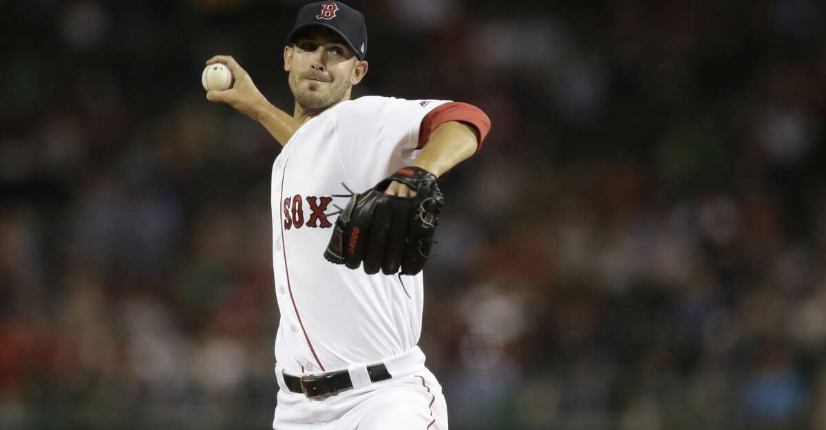 Boston Red Sox starting pitcher Rick Porcello delivers during the first inning of a baseball game at Fenway Park in Boston, Wednesday, Sept. 27, 2017. (AP Photo/Charles Krupa)