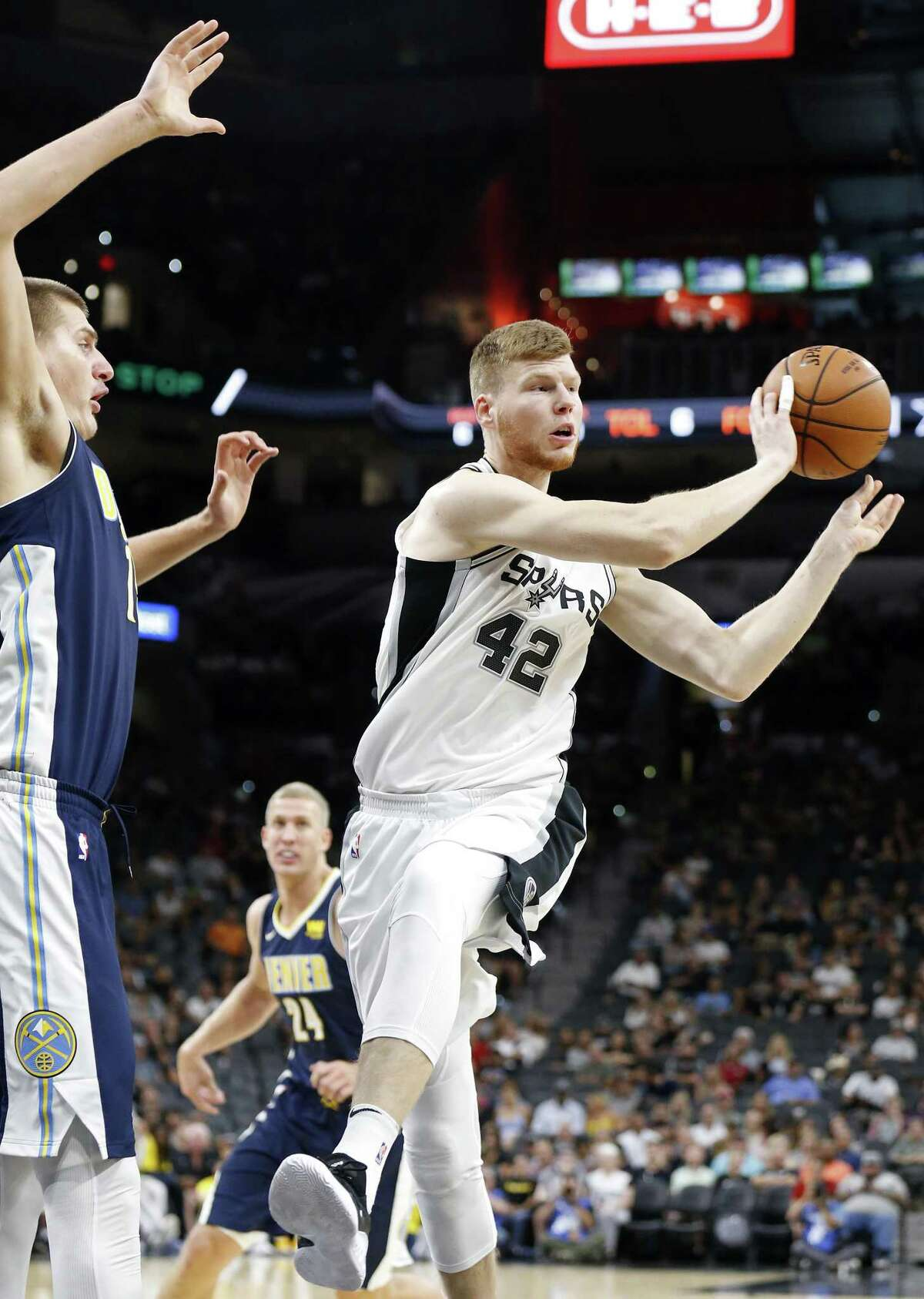 San Antonio Spurs?• Davis Bertans passes around Denver Nuggets?• Nikola Jokic during first half action of their preseason game held Sunday Oct. 8, 2017 at the AT&T Center.
