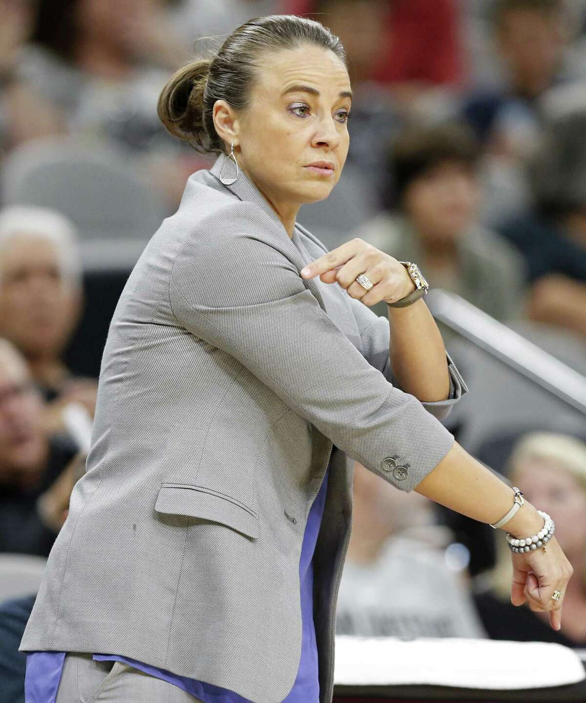 San Antonio Spurs assistant coach Becky Hammon calls a play during first half action of their preseason game against the Denver Nuggets Sunday Oct. 8, 2017 at the AT&T Center.