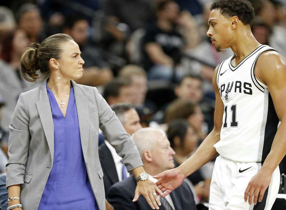 Spurs assistant coach Becky Hammon greets Bryn Forbes as he walks to the bench during first half action of a preseason game against the Denver Nuggets on Oct. 8, 2017 at the AT&T Center. Photo: Edward A. Ornelas /San Antonio Express-News / © 2017 San Antonio Express-News
