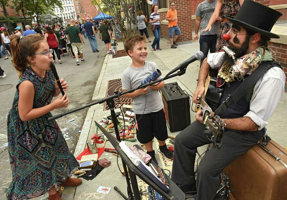 Sophia Flood and her brother Justin, 5, of Colonie play music with a street musician clown at The 11th Annual Troy ChowderFest in Monument Square on Sunday, Oct. 8, 2017 in Troy, N.Y. (Lori Van Buren / Times Union) Photo: Lori Van Buren / 20041740A