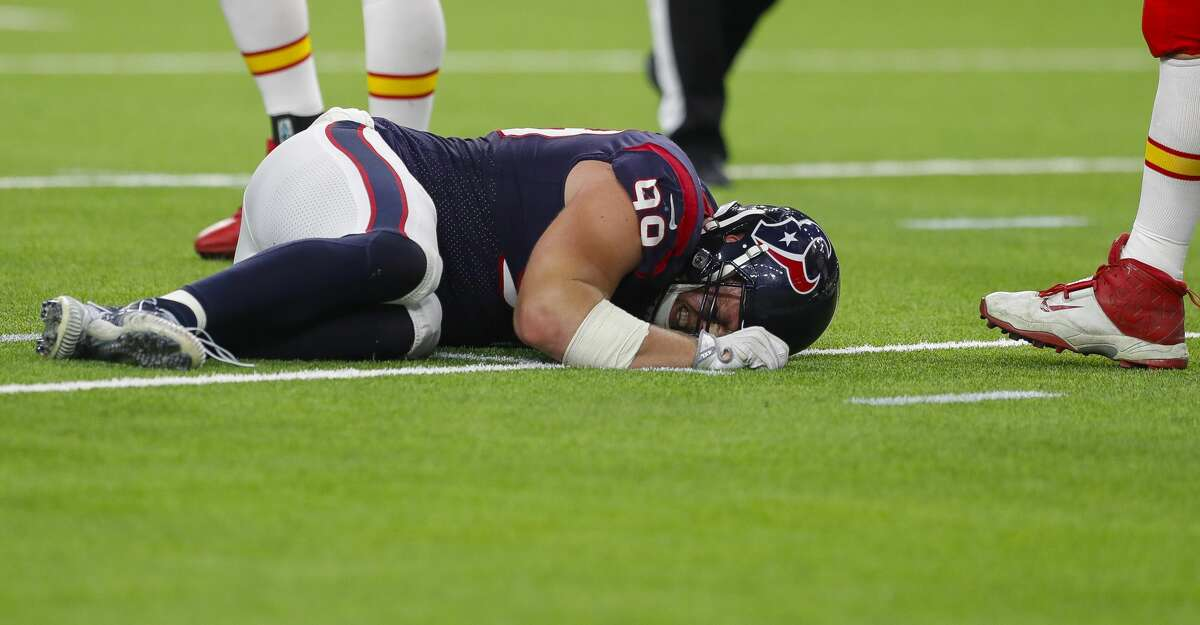 Houston Texans defensive end J.J. Watt (99) lays on the field hurt during the first quarter of an NFL football game at NRG Stadium on Sunday, Oct. 8, 2017, in Houston. ( Brett Coomer / Houston Chronicle )