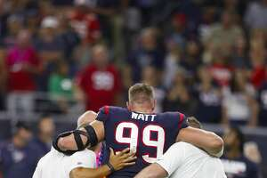 during the first quarter of an NFL football game at NRG StadiHouston Texans defensive end J.J. Watt (99) is helped off the field after being hurt during the first quarter of an NFL football game at NRG Stadium on Sunday, Oct. 8, 2017, in Houston. ( Brett Coomer / Houston Chronicle )