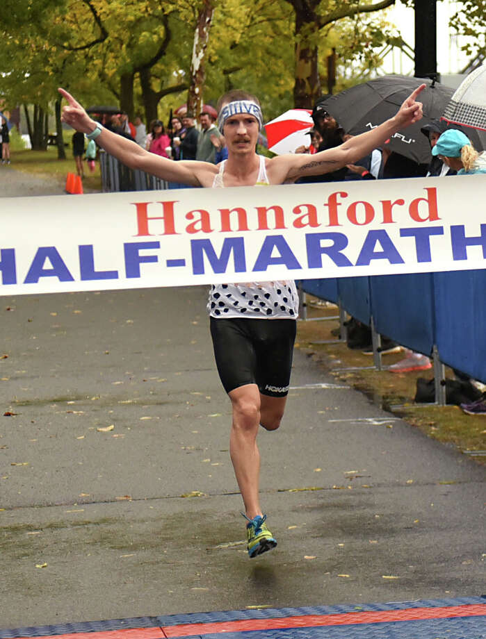 Tyler Andrews of Arlington, VA makes his way across the finish line as the men's Hannaford Half-Marathon winner at 1:07:33 at the Corning Preserve on Sunday, Oct. 8, 2017 in Albany, N.Y. The half marathon runners started at Colonie Town Park in Cohoes. (Lori Van Buren / Times Union) Photo: Lori Van Buren / 20041789A