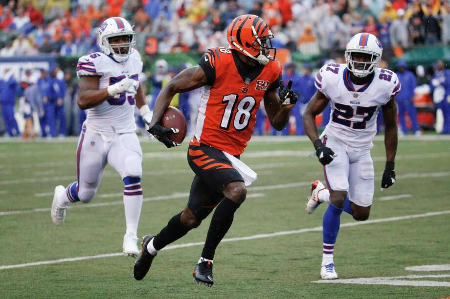 Cincinnati Bengals wide receiver A.J. Green (18) runs the ball against Buffalo Bills cornerback Tre'Davious White (27) in the second half of an NFL football game, Sunday, Oct. 8, 2017, in Cincinnati. (AP Photo/Frank Victores) ORG XMIT: OHJM139 Photo: Frank Victores / AP