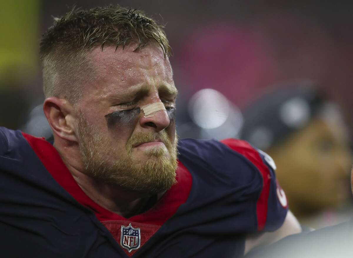 Houston Texans defensive end J.J. Watt (99) is helped off of the field after being injured during an NFL football game at NRG Stadium Sunday, Oct. 8, 2017 in Houston. ( Michael Ciaglo / Houston Chronicle)