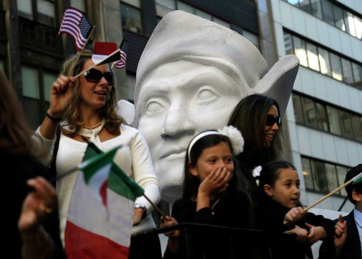 FILE - In this Oct. 12, 2015, file photo, participants in the Columbus Day Parade ride a float with a large bust of Christopher Columbus in New York. A movement to abolish Columbus Day, and officially replace it with Indigenous Peoples' Day, has new momentum but the gesture to recognize victims of European colonialism has also prompted howls of outrage from some Italian Americans, who say eliminating their festival of ethnic pride is culturally insensitive, too. (AP Photo/Seth Wenig) ORG XMIT: NYR402