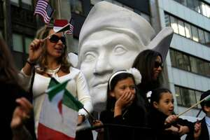FILE - In this Oct. 12, 2015, file photo, participants in the Columbus Day Parade ride a float with a large bust of Christopher Columbus in New York. A movement to abolish Columbus Day and replace it with Indigenous Peoples Day has new momentum but the gesture to recognize victims of European colonialism has also prompted howls of outrage from some Italian Americans, who say eliminating their festival of ethnic pride is culturally insensitive, too. (AP Photo/Seth Wenig) ORG XMIT: NYR402