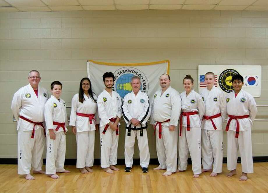 Eight students from Taekwon-Do Training Centers were promoted to 1st Dan black belts recently. Pictured, from left, are Joey Storer, Anthony Storer, Shreya Nagarkar, Irshad Husain, Master Terry Batch, Andrew Gordon, Melanie Bailey, Chris Storer and Shubhan Nagarkar. (Photo provided by Sandi Beaudoin)