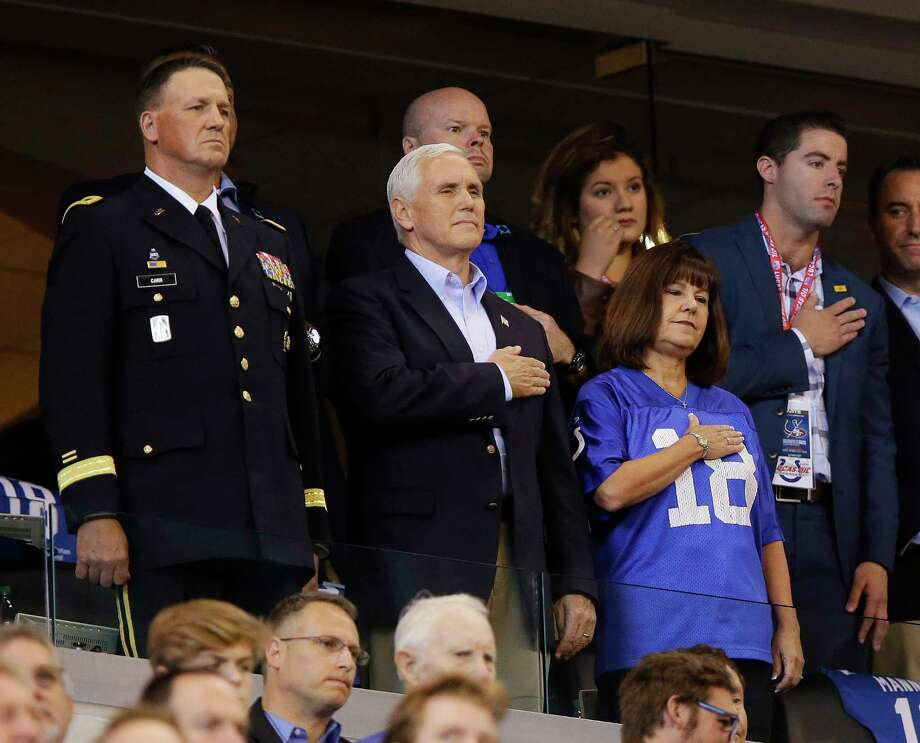 Vice President Mike Pence, front center, stands during the playing of the national anthem before an NFL football game between the Indianapolis Colts and the San Francisco 49ers, Sunday, Oct. 8, 2017, in Indianapolis. (AP Photo/Michael Conroy) ORG XMIT: NAS111 Photo: Michael Conroy / Copyright 2017 The Associated Press. All rights reserved.