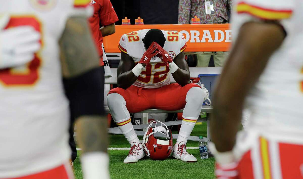 Kansas City Chiefs linebacker Tanoh Kpassagnon (92) sits on the bench during the national anthem before an NFL football game against the Houston Texans, Sunday, Oct. 8, 2017, in Houston. (AP Photo/David J. Phillip)