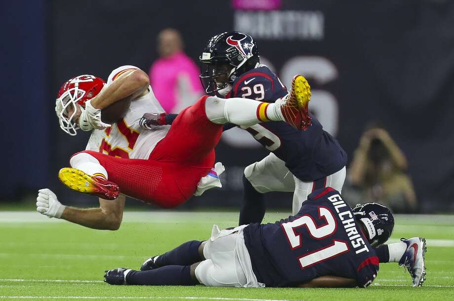 Kansas City Chiefs tight end Travis Kelce (87) is tackled by Houston Texans free safety Andre Hal (29) and strong safety Marcus Gilchrist (21) during the second quarter of an NFL football game at NRG Stadium Sunday, Oct. 8, 2017 in Houston. ( Michael Ciaglo / Houston Chronicle) Photo: Michael Ciaglo/Houston Chronicle