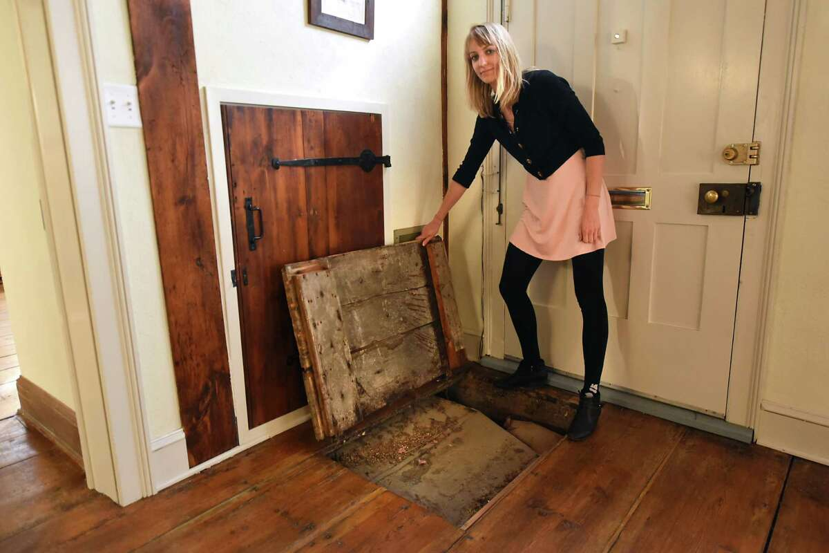 Mary Zawacki, executive director of the Schenectady County Historical Society, demonstrates a trap door by the front door as she gives a tour of the Hendrick Brouwer House at 14 N. Church St. on Wednesday, Oct. 4, 2017 in Schenectady, N.Y. The house, dated to 1727, was donated by the Kindl Family to the Schenectady County Historical Society. (Lori Van Buren / Times Union)