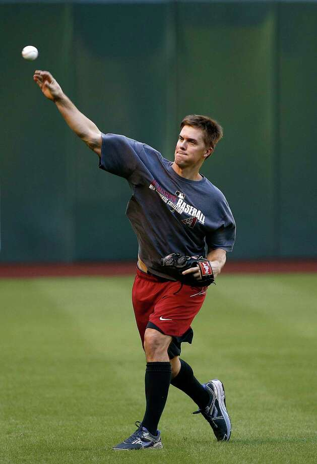 Arizona Diamondbacks starting pitcher Zack Greinke does long throws during practice prior to Game 3 of baseball's National League Division Series against the Los Angeles Dodgers, Sunday, Oct. 8, 2017, in Phoenix. (AP Photo/Ross D. Franklin) ORG XMIT: PNC103 Photo: Ross D. Franklin / Copyright 2017 The Associated Press. All rights reserved.