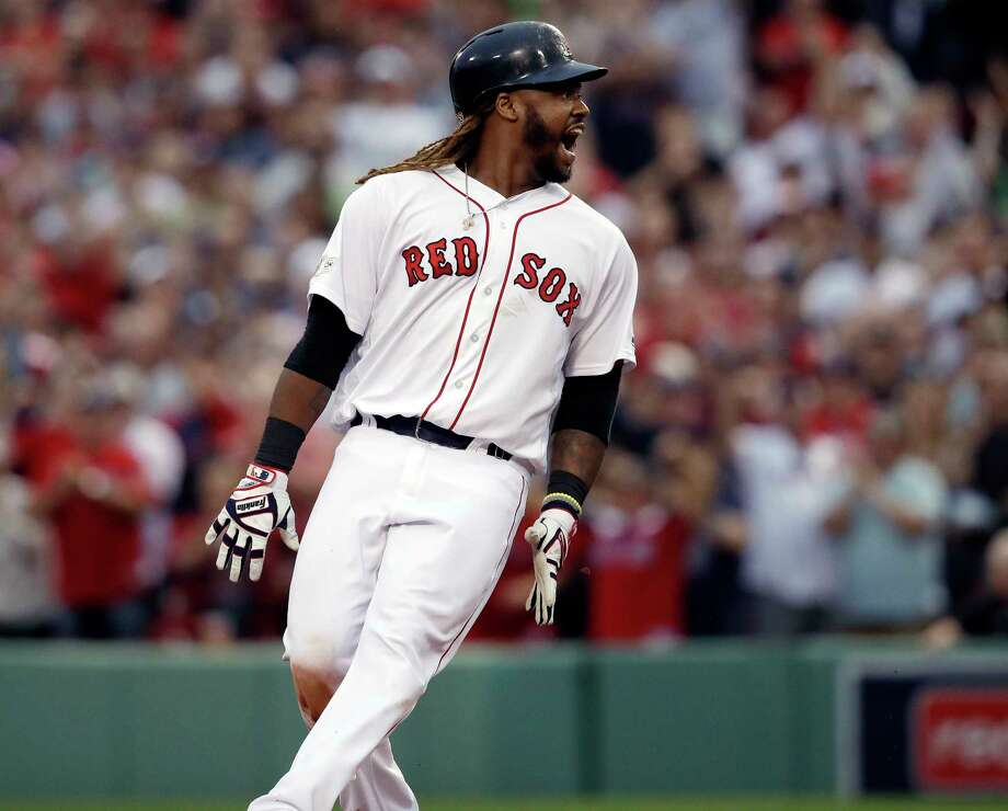 Boston Red Sox designated hitter Hanley Ramirez shouts after hitting a two-run RBI double during the seventh inning in Game 3 of baseball's American League Division Series against the Houston Astros, Sunday, Oct. 8, 2017, in Boston. (AP Photo/Charles Krupa) ORG XMIT: BXF147 Photo: Charles Krupa / AP2017