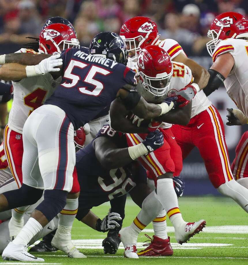 Kansas City Chiefs running back Kareem Hunt (27) tries to get away from Houston Texans inside linebacker Benardrick McKinney (55) and nose tackle D.J. Reader (98) during the third quarter of an NFL football game at NRG Stadium Sunday, Oct. 8, 2017 in Houston. ( Michael Ciaglo / Houston Chronicle) Photo: Michael Ciaglo/Houston Chronicle