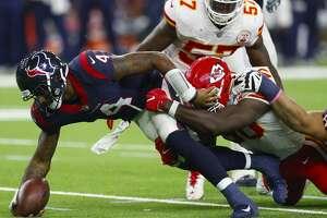 Houston Texans quarterback Deshaun Watson (4) stretches for extra yardage during the fourth quarter of an NFL football game at NRG Stadium on Sunday, Oct. 8, 2017, in Houston. ( Brett Coomer / Houston Chronicle )