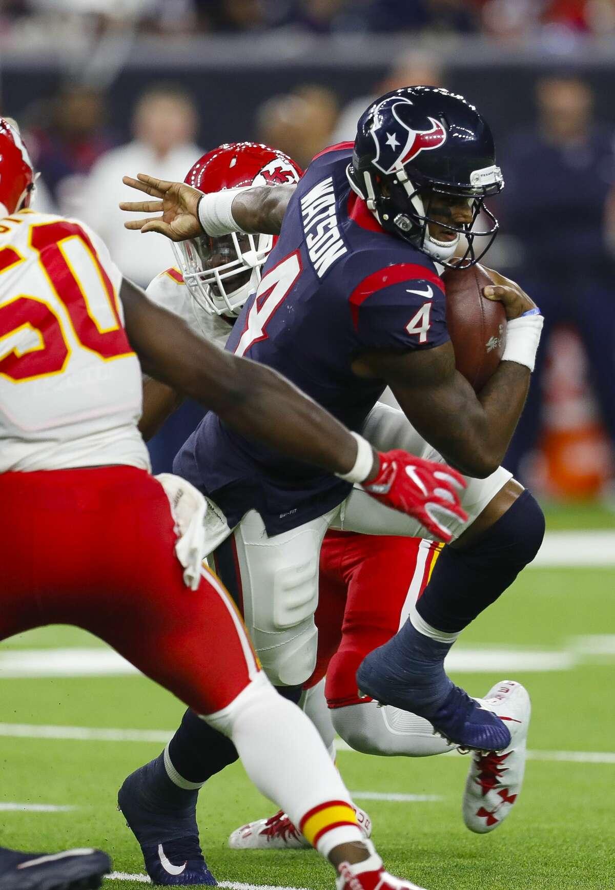 Houston Texans quarterback Deshaun Watson (4) looks for running space during the fourth quarter of an NFL football game at NRG Stadium on Sunday, Oct. 8, 2017, in Houston. ( Brett Coomer / Houston Chronicle )