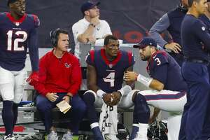 Houston Texans quarterback Deshaun Watson (4) sits on the bench with backup quarterback Tom Savage (3) during the fourth quarter of an NFL football game at NRG Stadium on Sunday, Oct. 8, 2017, in Houston. ( Brett Coomer / Houston Chronicle )