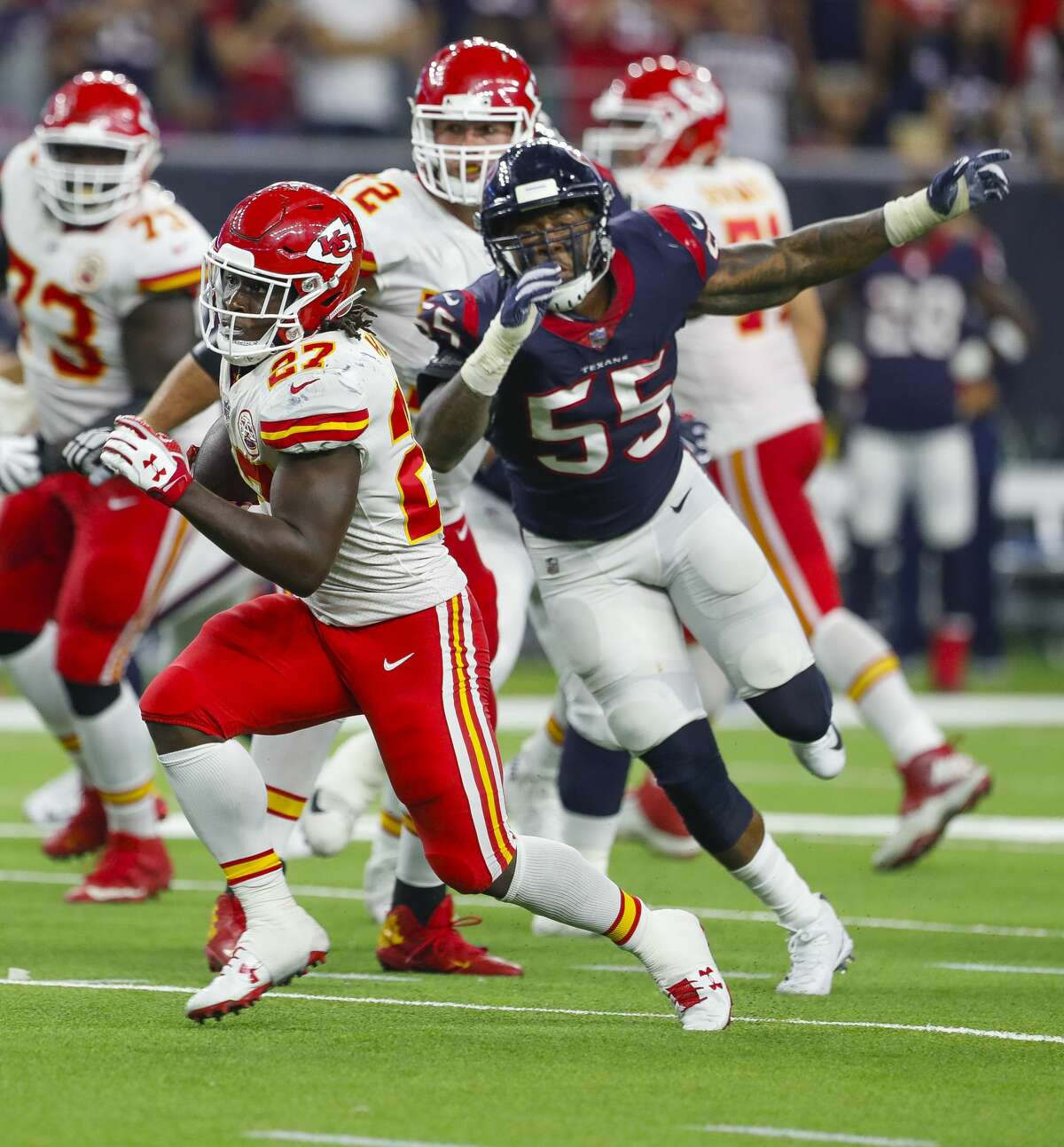 Kansas City Chiefs running back Kareem Hunt (27) sprints downfield past Houston Texans inside linebacker Benardrick McKinney (55) during the fourth quarter of an NFL football game at NRG Stadium on Sunday, Oct. 8, 2017, in Houston. ( Brett Coomer / Houston Chronicle )