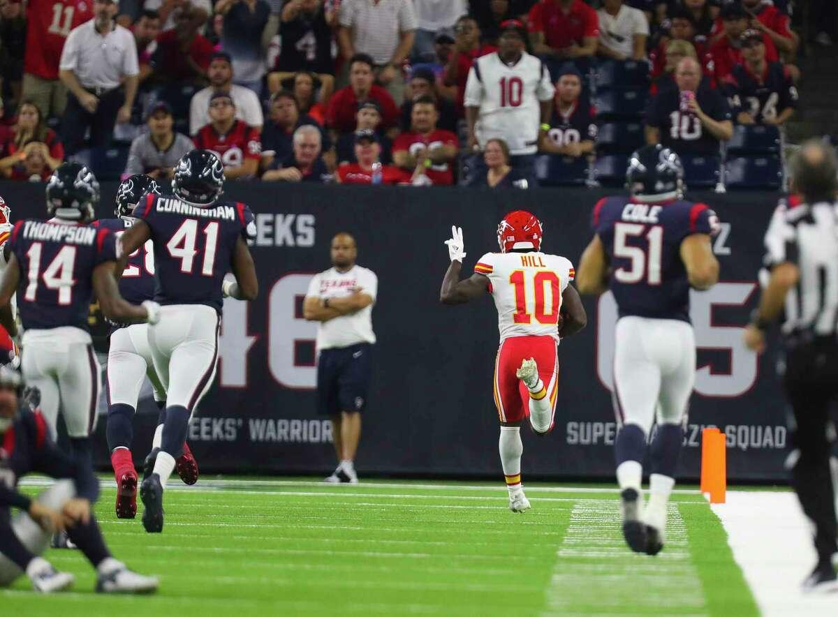 Kansas City's Tyreek Hill (10) runs back an 82-yard punt return for a touchdown during the fourth quarter Sunday night at NRG Stadium.