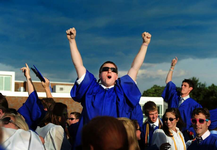 Graduate Sam Risley stands on his seat and throws his arms in the air at the end of the 2010 Fairfield Ludlowe High School commencement ceremony Thursday June 24 at the school. Photo: Autumn Driscoll / Connecticut Post