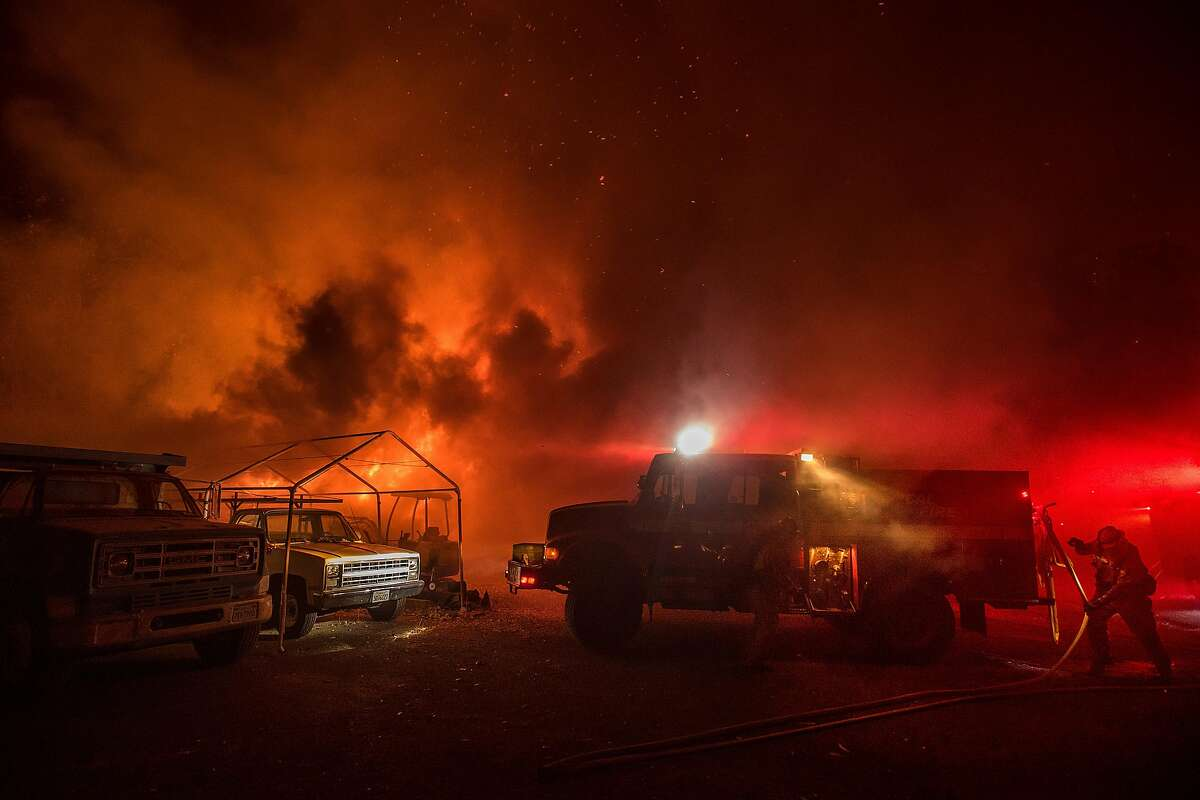 Firefighters work to save structures on Soda Canyon Road in Napa, Calif., on Monday, Oct. 9, 2017.