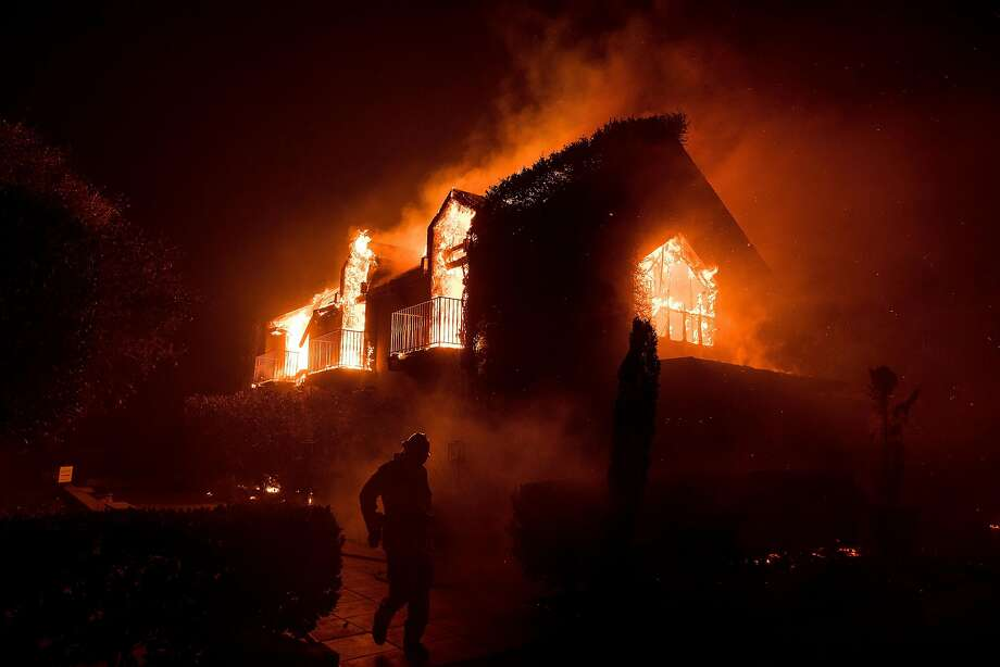 Flames consume a building at Signorello Estate in Napa. Photo: Noah Berger, Special To The Chronicle