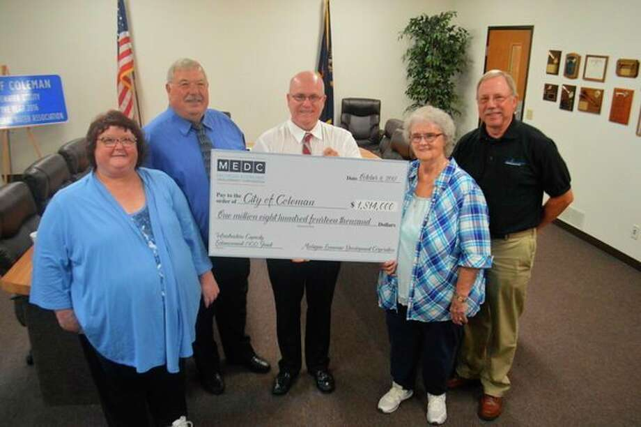 Coleman city officials Tammy Goffnett, Bill Cozat, Steve Miller and JoMac Rydman, with Gary Bartow, Fleis & VandenBrink project manager, at the presentation of a $1.8 million grant for infrastructure upgrades. (Photo provided)