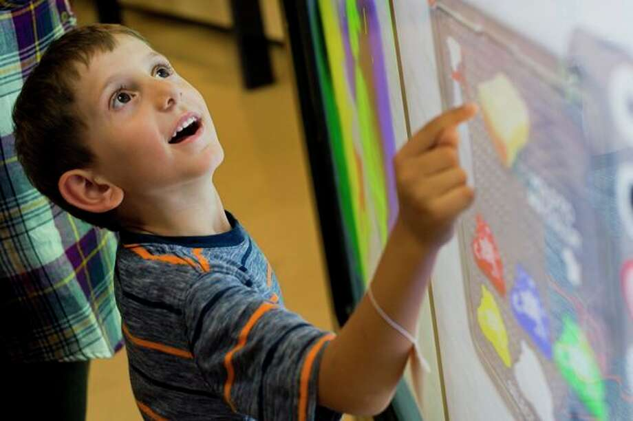 Adam Doghmi of Midland, 6, plays with a digital touch screen canvas inside the Midland Center for the Arts' Hall of Ideas on Saturday. Adam and his parents and two siblings moved to Midland just a few weeks ago, and this was their first visit to the Midland Center for the Arts. (Katy Kildee/kkildee@mdn.net)