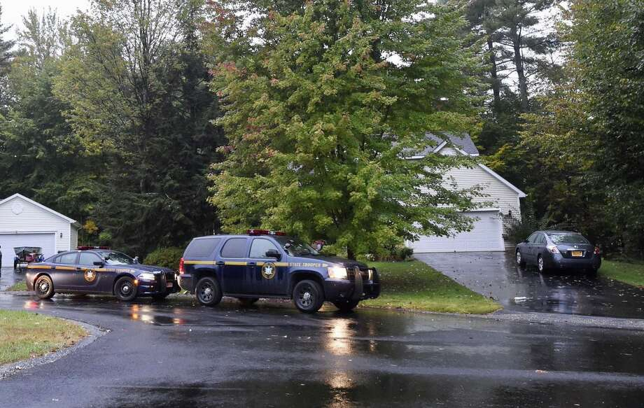 State Police remained at a home on Cheyenne Court in Wilton Monday morning, the day after investigators spent part of the day examining the home.  Photo: Skip Dicketein / Times Union