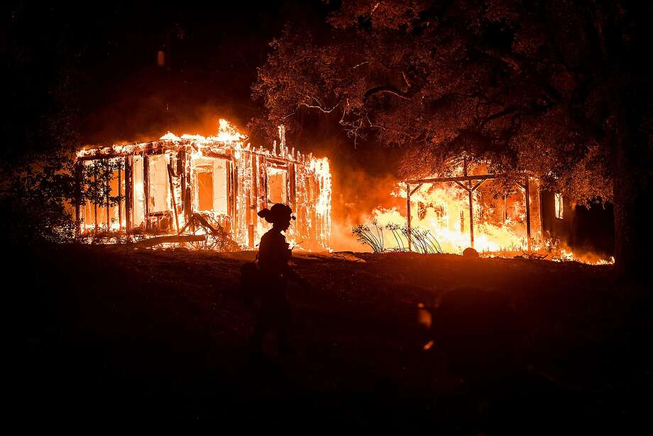Flames consume a structure on Partrick Rd. in Napa, Calif., on Monday, Oct. 9, 2017. Photo: Noah Berger, Special To The Chronicle