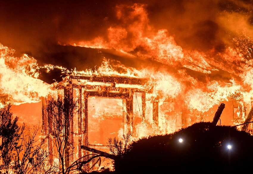 Flame consume a structure on Partrick Rd. in Napa, Calif., on Monday, Oct. 9, 2017.