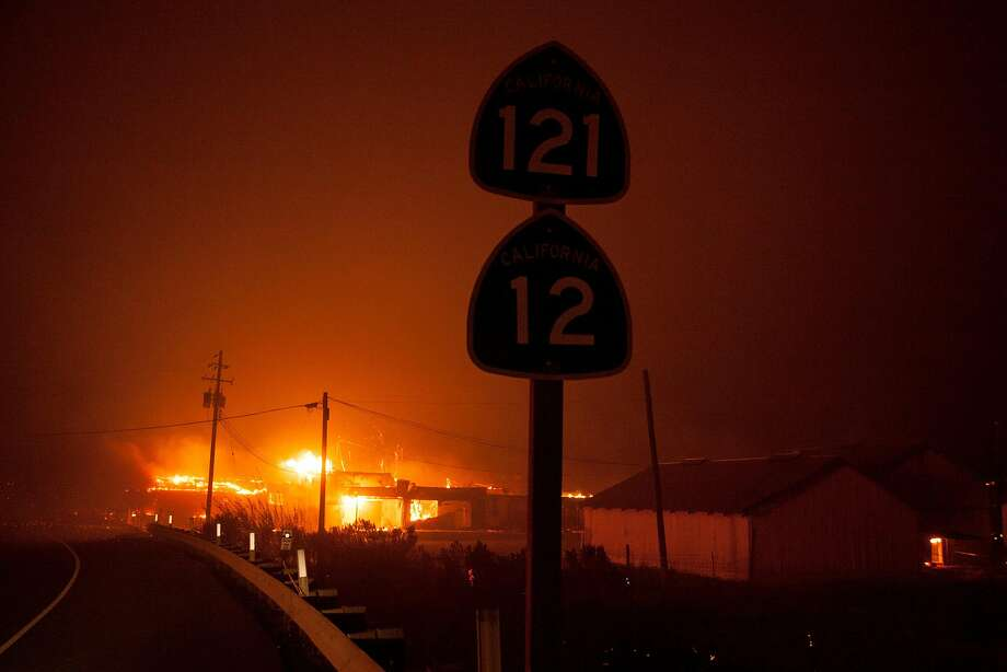 Buildings of a dairy ranch along Hwy. 12 burned out of control as a fast moving wind whipped wild fire raged though the Napa/Sonoma wine region in NAPA, CALIFORNIA, USA 9 Oct 2017.  Multiple fire have erupted in Napa, Sonoma, Calistoga and the Santa Rosa area, burning homes and wineries. Mandatory evacuations have be displaced hundreds of residents through out the area. Photo: Peter DaSilva, Special To The Chronicle