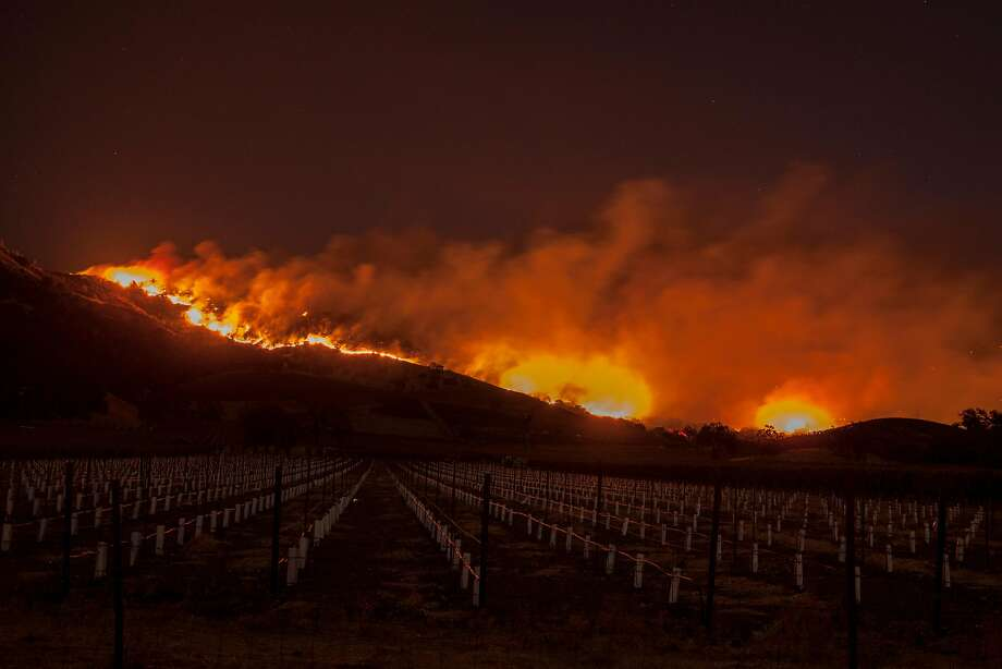 Flames spread through the hills above Napa Valley's Silverado Trail during the Wine Country fires Oct. 9. Photo: Peter DaSilva, Special To The Chronicle