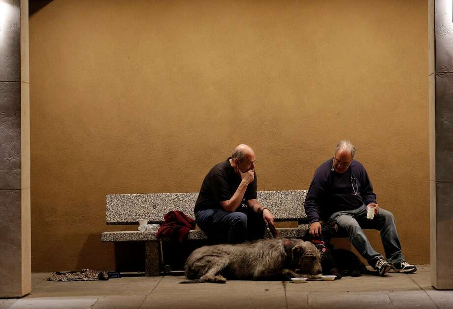 Peter Gennet sits with Dr. Larry Posner with Peter's dogs Quinn, and Rufus at Crosswalk Church after they were both evacuated from their homes in Napa, Calif., on Monday, October 9, 2017. Several large wildfires consumed several structures and threatened hundreds of others in Napa and Sonoma Counties. Photo: Carlos Avila Gonzalez, The Chronicle