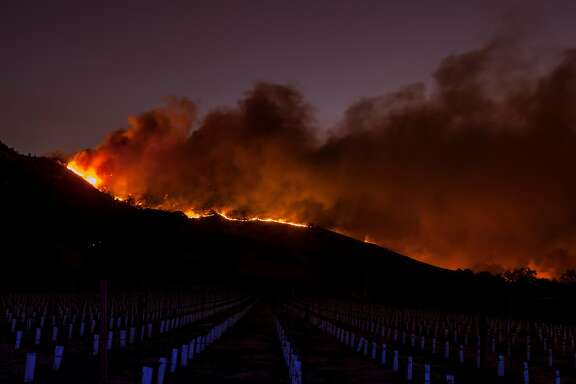 Flames moved through the hills above the Silverado Trail as a fast moving wind-whipped-wild fire raged though the Napa/Sonoma wine region in Napa on Oct. 9, 2017. Multiple fire that erupted in Napa, Sonoma, Calistoga and the Santa Rosa area have burned homes and wineries. Mandatory evacuations have be displaced hundreds of residents through out the area.