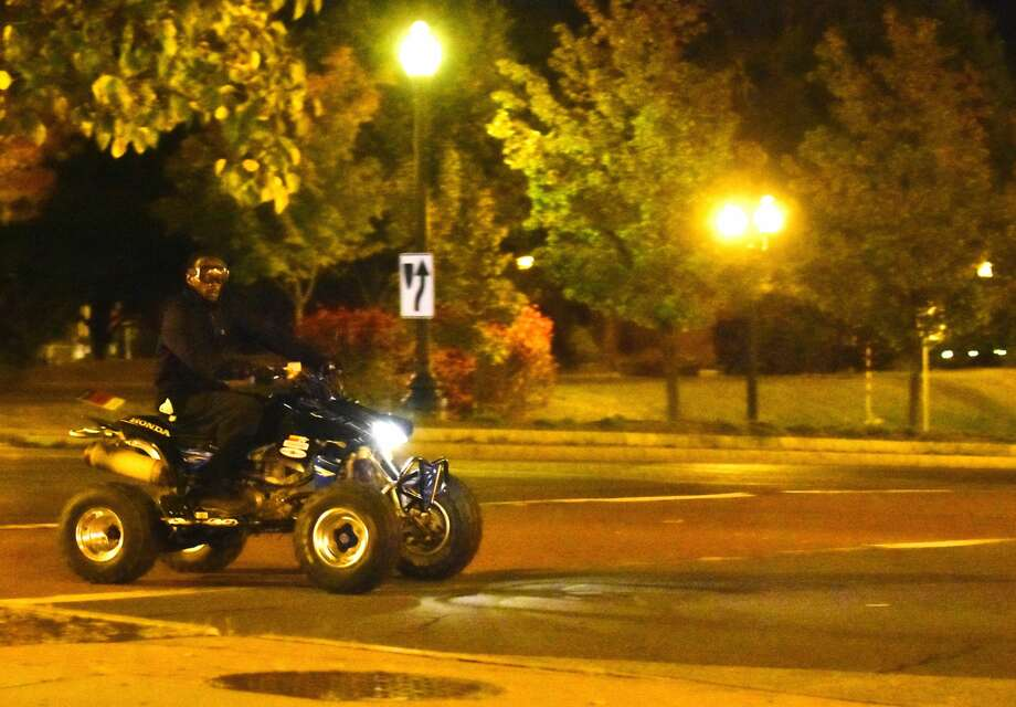 A man rides an all-terrain vehicle near the Palace Theatre in downtown Albany on Sunday. Police in Albany say people riding non-licensed off-road vehicles on city streets is a problem that has ebbed and flowed over the years. Photo: Steve Barnes / Times Union