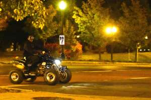 A man rides an all-terrain vehicle near the Palace Theatre in downtown Albany on Sunday. Police in Albany say people riding non-licensed off-road vehicles on city streets is a problem that has ebbed and flowed over the years.