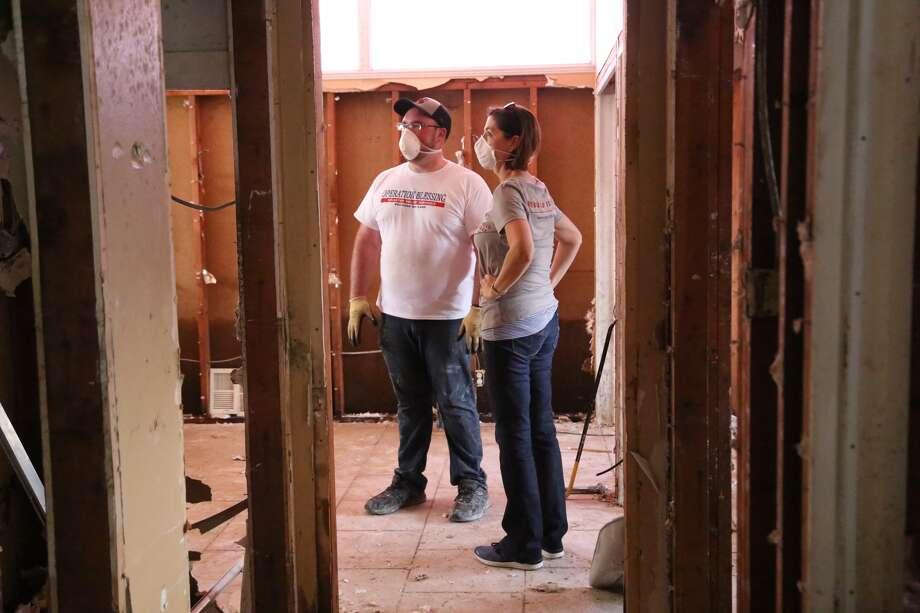 Lori Fey of Rebuild Texas Fund surveys Hurricane Harvey damage with Operation Blessing.
