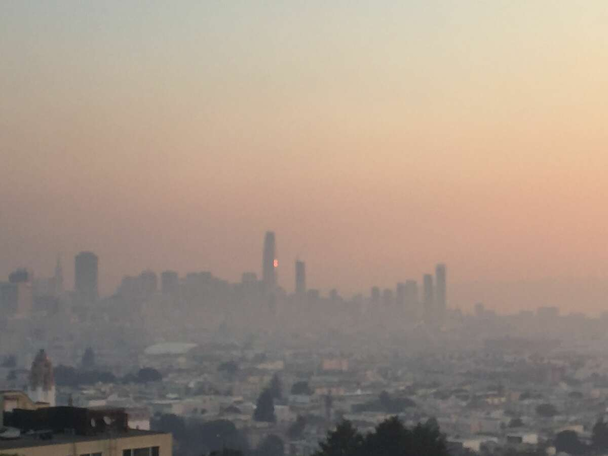 Views of San Francisco's skyline are smoke-filled on the morning of Oct. 9 as multiple wildfires burn in Mendocino and Sonoma counties.