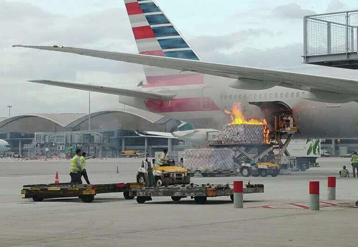 A fire breaks out on loading equipment in the process of loading an American Airlines jet at Hong Kong airport on Monday Oct. 9, 2017. >> See the world's highest-ranked airlines of 2017...