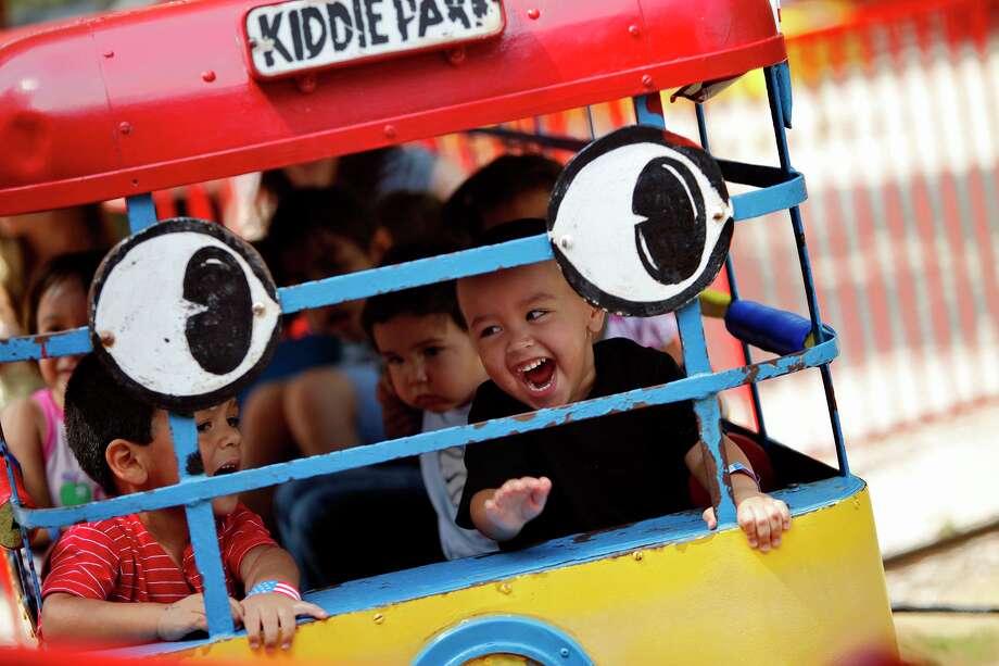 Joe Anthony Borrego, 2 (left), and Julian Sanchez, 2, enjoy the school bus ride at Kiddie Park in San Antonio in 2009. Photo: Lisa Krantz /San Antonio Express-News / lkrantz@express-news.net