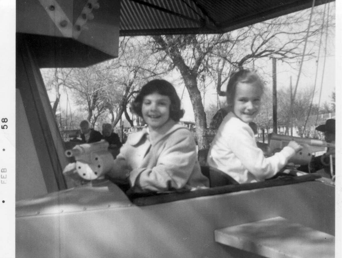 Its original little cars and warplanes still spin, too. Two of Kiddie Park's oldest ongoing amusements are its miniature automobiles from the 1920s and World War II-era airplanes from the 1940s. Pictured are Cathy Raffkind and Christine Posey (right) in a 1958 family snapshot.