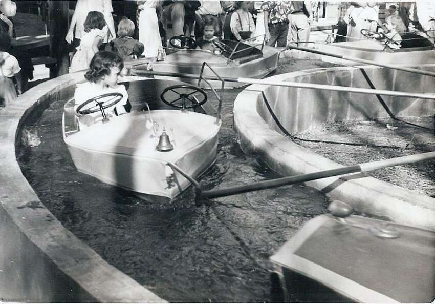 A child on the Kiddie Park boat ride in 1953.