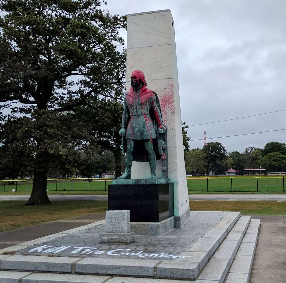 "The Columbus statue in Seaside Park in Bridgeport, Conn., along with statues in Norwalk, New Haven and Middletown, was vandalized. The Bridgeport statue was covered in red paint along with the words ""Kill The Colonizer"" painted on the base. Photo: Cedar Attanasio / Hearst Connecticut Media / Connecticut Post"